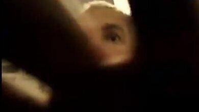 Базулько закрывает рукой камеру журналиста