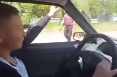 стреляющий за рулем